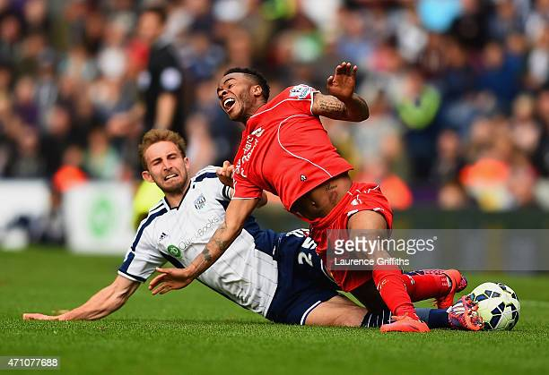 Craig Dawson of West Brom tackles Raheem Sterling of Liverpool during the Barclays Premier League match between West Bromwich Albion and Liverpool at...