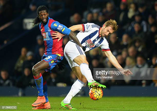 Craig Dawson of West Bromwich Albion and Emmanuel Adebayor of Crystal Palace compete for the ball during the Barclays Premier League match between...