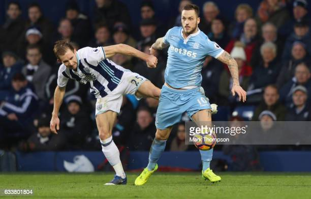 Craig Dawson of West Bromwich Albion and Marko Arnautovic of Stoke City battle for possession during the Premier League match between West Bromwich...