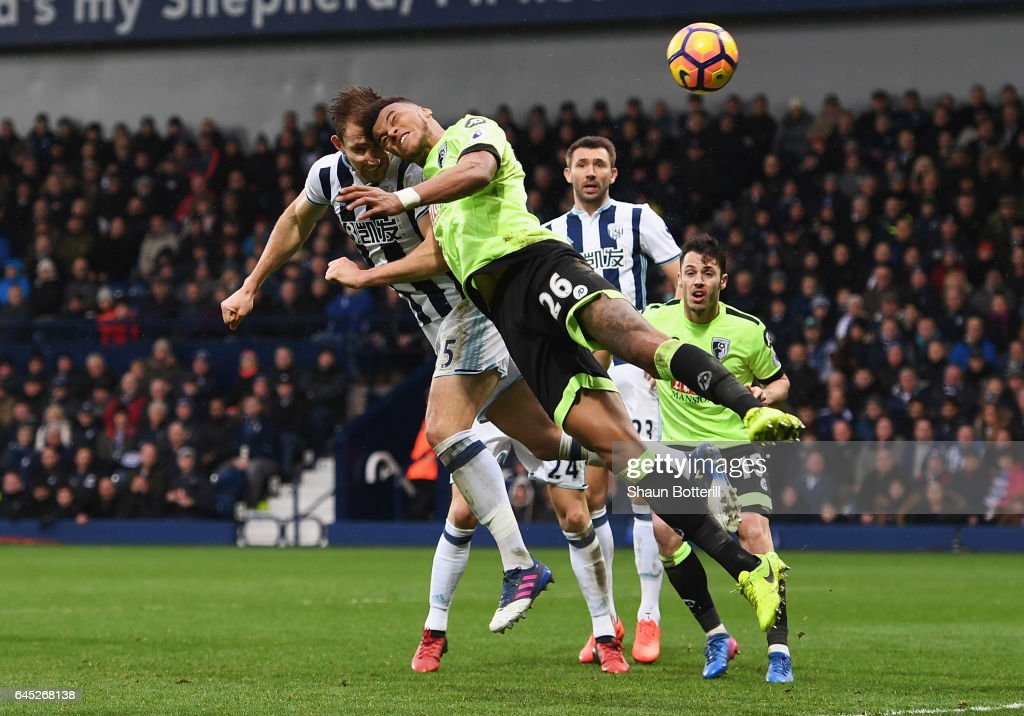 Craig Dawson of West Bromwich Albion (L) and Tyrone Mings of AFC Bournemouth (R) battle to win a header during the Premier League match between West Bromwich Albion and AFC Bournemouth at The Hawthorns on February 25, 2017 in West Bromwich, England.