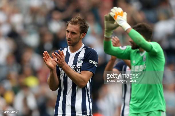 Craig Dawson of West Bromwich Albion applauds the West Bromwich Albion Fans at the end of the match during the Premier League match between West...