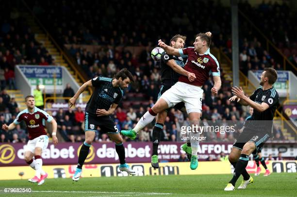 Craig Dawson of West Bromwich Albion battles with Sam Vokes of Burnley during the Premier League match between Burnley and West Bromwich Albion at...