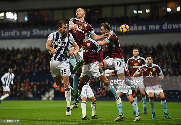 Craig Dawson of West Bromwich Albion Ben Mee Matthew Lowton and Ashley Barnes of Burnley jump for the ball during the Premier League match between...