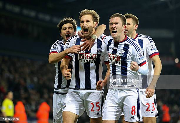 Craig Dawson of West Bromwich Albion celebrates after scoring a goal to make it 20 with Claudio Yacob and Craig Gardner during the Barclays Premier...