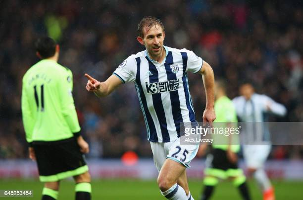 Craig Dawson of West Bromwich Albion celebrates scoring his sides first goal during the Premier League match between West Bromwich Albion and AFC...