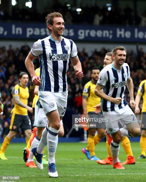 Craig Dawson of West Bromwich Albion celebrates scoring his sides first goal during the Premier League match between West Bromwich Albion and Arsenal...