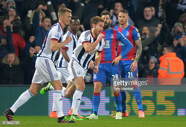 Craig Dawson of West Bromwich Albion celebrates scoring his team's second goal during the Barclays Premier League match between West Bromwich Albion...
