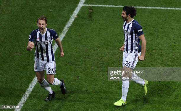 Craig Dawson of West Bromwich Albion celebrates with Ahmed Hegazy after scoring a goal to make it 20 during the Premier League match between West...
