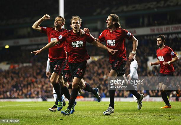 Craig Dawson of West Bromwich Albion celebrates with team mates as he scores their first and equalising goal during the Barclays Premier League match...