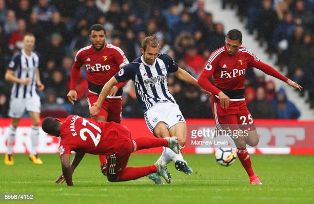 Craig Dawson of West Bromwich Albion competes for the ball against Christian Kabasele and Jose Holebas of Watford during the Premier League match...