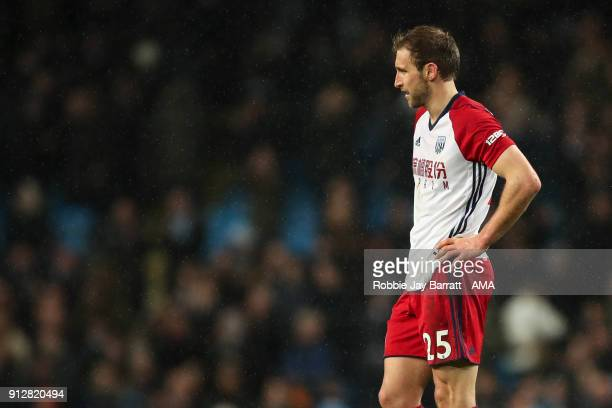 Craig Dawson of West Bromwich Albion dejected at full time during the Premier League match between Manchester City and West Bromwich Albion at Etihad...