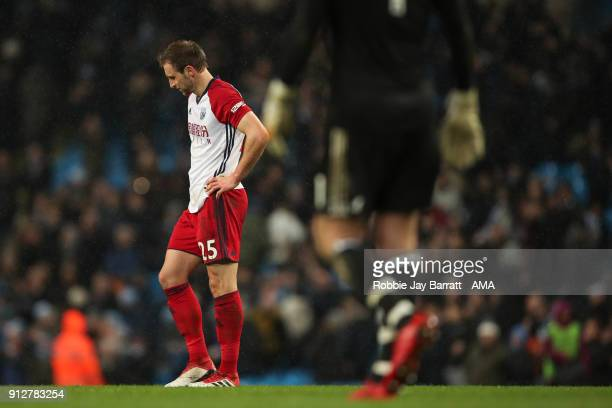 Craig Dawson of West Bromwich Albion dejected during the Premier League match between Manchester City and West Bromwich Albion at Etihad Stadium on...