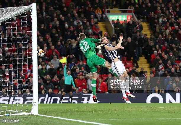 Craig Dawson of West Bromwich Albion has his goal ruled out for off side as he beats Simon Mignolet of Liverpool in the air during the The Emirates...