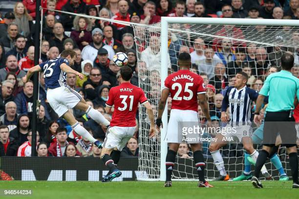 Craig Dawson of West Bromwich Albion heads toward the goal from a corner but fails to score during the Premier League match between Manchester United...