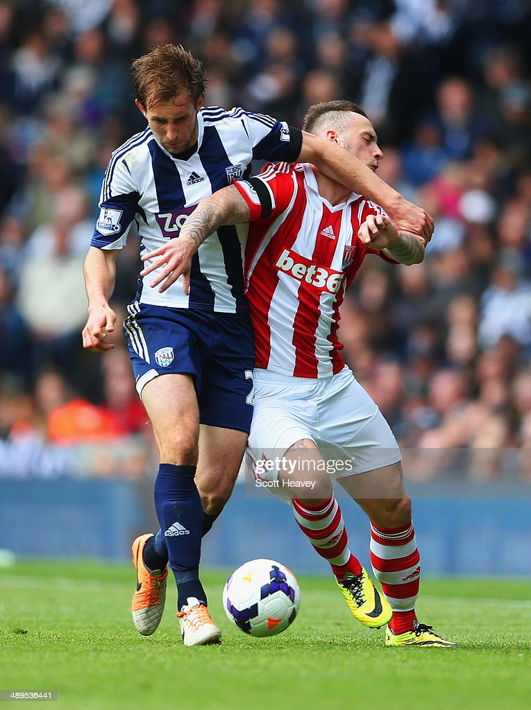 Craig Dawson of West Bromwich Albion holds off Marko Arnautovic of Stoke City during the Barclays Premier League match between West Bromwich Albion and Stoke City at The Hawthorns on May 11, 2014 in West Bromwich, England.