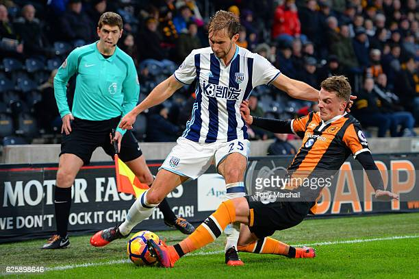 Craig Dawson of West Bromwich Albion is tackled by Josh Tymon of Hull City during the Premier League match between Hull City and West Bromwich Albion...