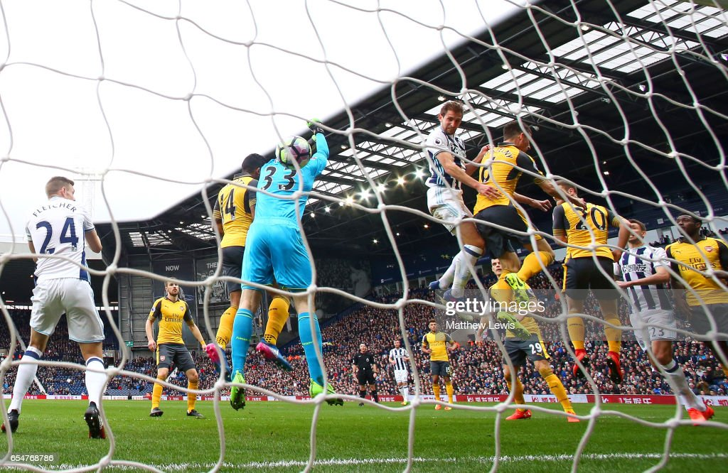 Craig Dawson of West Bromwich Albion (R) scores his sides first goal past Petr Cech of Arsenal (L) during the Premier League match between West Bromwich Albion and Arsenal at The Hawthorns on March 18, 2017 in West Bromwich, England.