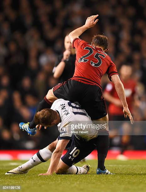 Craig Dawson of West Bromwich Albion tangles with Harry Kane of Tottenham Hotspur during the Barclays Premier League match between Tottenham Hotspur...