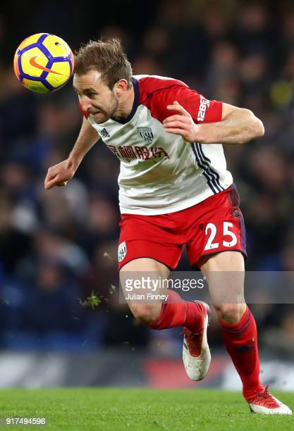 Craig Dawson of West Bromwich Albion wins a header during the Premier League match between Chelsea and West Bromwich Albion at Stamford Bridge on...
