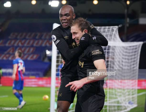 Craig Dawson of West Ham United celebrates with Angelo Ogbonna after scoring their team's third goal during the Premier League match between Crystal...