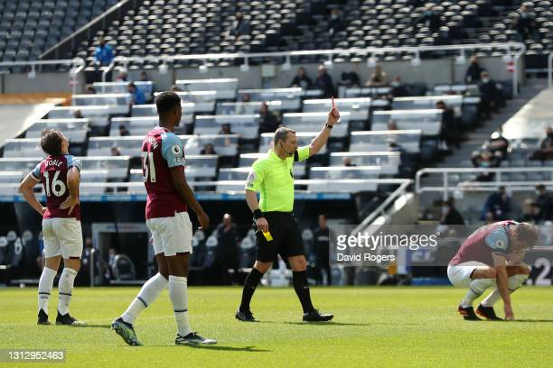 Craig Dawson of West Ham United is shown a red card by referee Kevin Friend during the Premier League match between Newcastle United and West Ham...