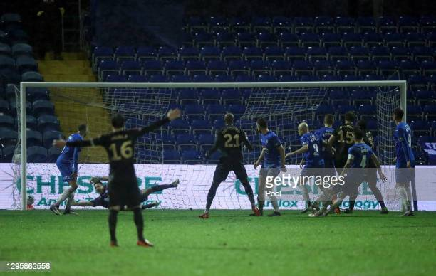 Craig Dawson of West Ham United scores their team's first goal past Ben Hinchliffe of Stockport County during the FA Cup Third Round match between...