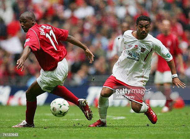Craig Dobson of Stevenage Borough evades Michael Blackwood of Kidderminster Harriers during the FA Trophy Final match between Kidderminster Harriers...