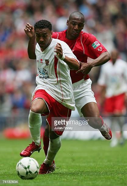 Craig Dobson of Stevenage Borough holds off Michael Blackwood of Kidderminster Harriers during the FA Trophy Final match between Kidderminster...