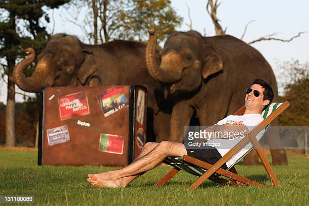 Craig Doyle 'thrillaxes' as he poses for pictures with an elephant during an iExplore photo call to reveal the results of a survey by new travel...
