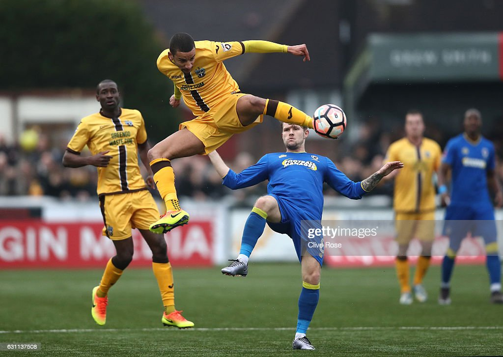Craig Eastmond of Sutton United acrobatically kicks the ball during The Emirates FA Cup Third Round match between Sutton United and AFC Wimbledon at the Borough Sports Ground on January 7, 2017 in Sutton, England.