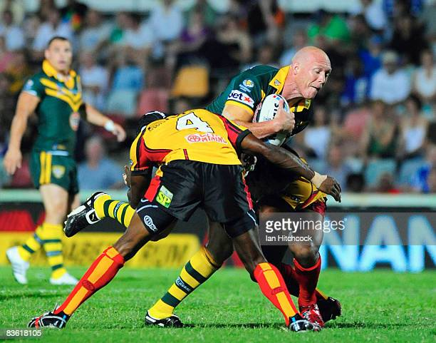Craig Fitzgibbon of Australia is wrapped up the PNG defence during the 2008 Rugby League World Cup Pool 1 match between Papua New Guinea and the...