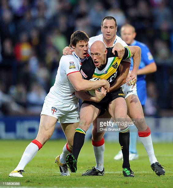 Craig Fitzgibbon of Exiles is tackled by Adrian Morley and Joel Tomkins of England during the International Origin match between England and Exiles...