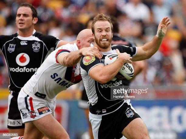Craig Fitzgibbon of the Roosters holds onto Ian Henderson of the Warriors during the round six NRL match between the Warriors and the Sydney Roosters...