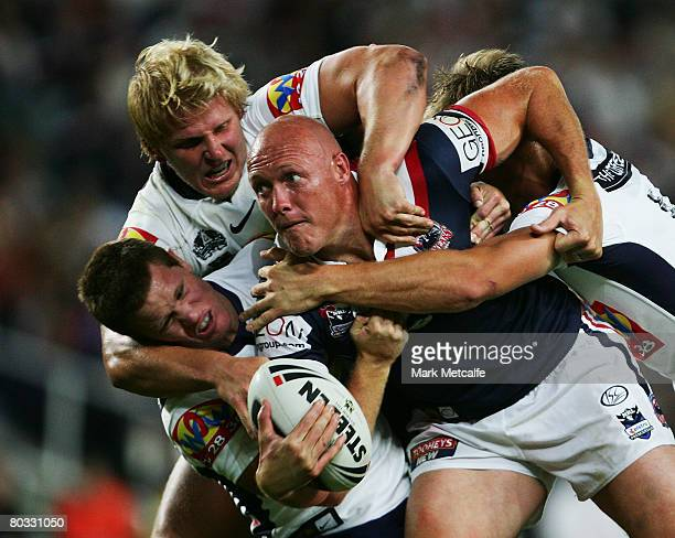 Craig Fitzgibbon of the Roosters is tackled during the round two NRL match between the Sydney Roosters and the Brisbane Broncos at the Sydney...