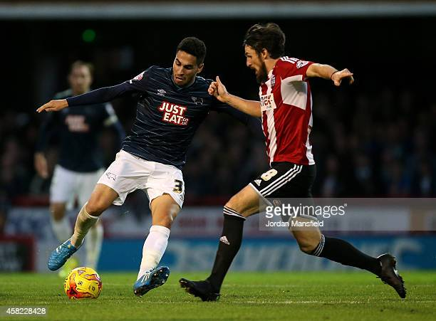 Craig Forsyth of Derby controls the ball under pressure from Jonathan Douglas of Brentford during the Sky Bet Championship match between Brentford...
