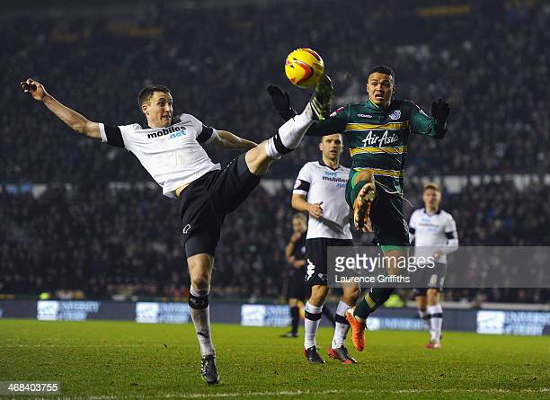 Craig Forsyth of Derby County battles with Jermaine Jenas of Queens Park Rangers during the Sky Bet Championship match between Derby County and...