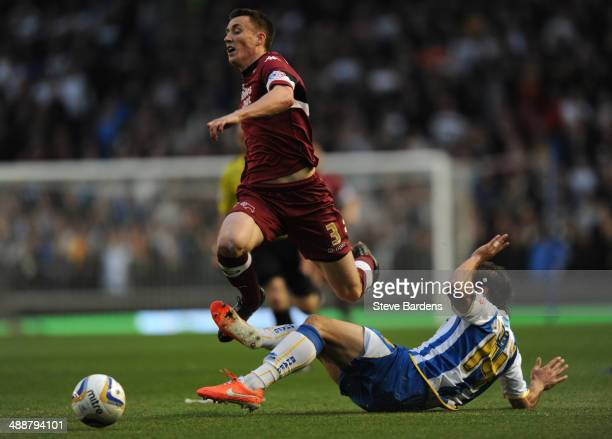 Craig Forsyth of Derby County is tackled by Inigo Calderon of Brighton & Hove Albion during the Sky Bet Championship Play Off semi final first leg...
