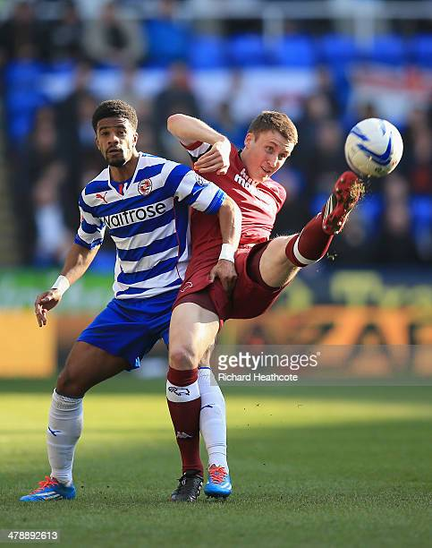 Craig Forsyth of Derby holds off Garath McCleary of Reading during the Sky Bet Championship match between Reading and Derby County at the Madejski...