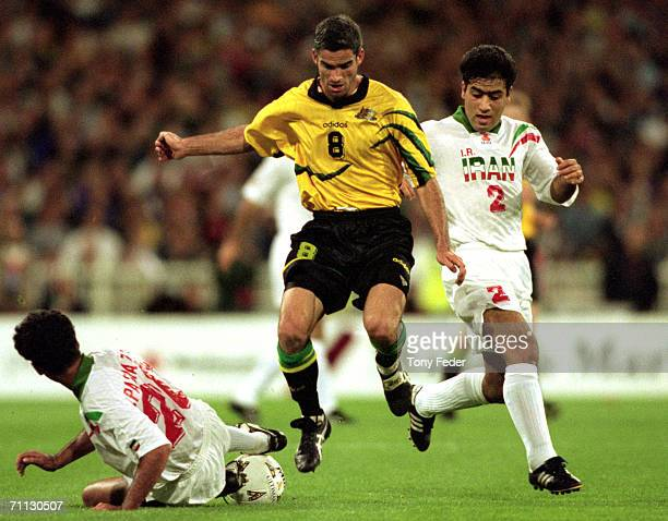 Craig Foster of the Socceroos tries to avoid a challenge from his opponent during the 2nd leg of the World Cup Qualifier between Australia and Iran...