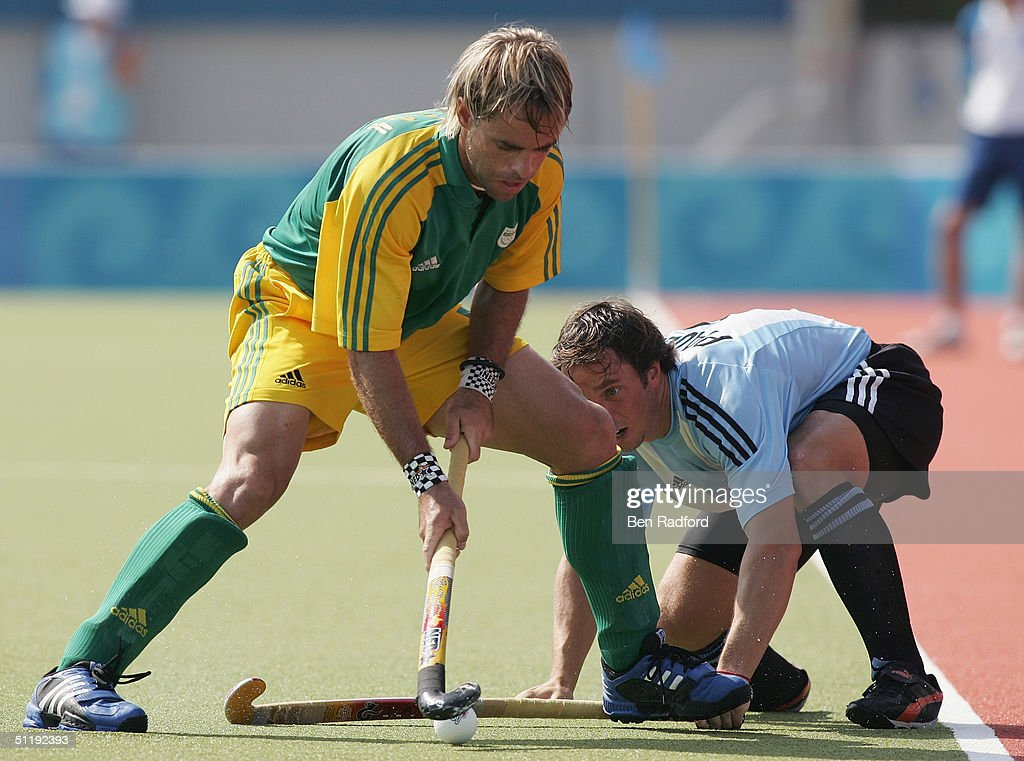 Craig Fulton of South Africa controls the ball against Mario Almada of Argentina in the men's field hockey preliminaries on August 15, 2004 during the Athens 2004 Summer Olympic Games at the Helliniko Olympic Complex Hockey Centre in Athens, Greece. South Africa defeated Argentina 2-1.