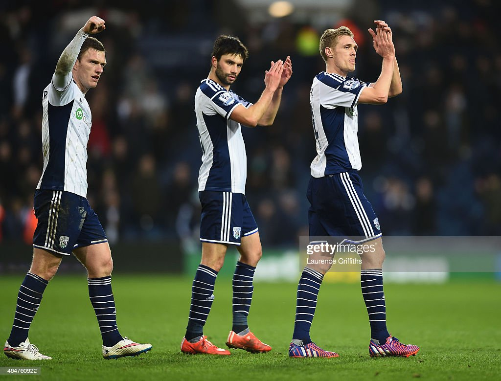 Craig Gardner, Claudio Yacob and Darren Fletcher of West Bromwich Albion applaud the crowd after victory in the Barclays Premier League match between West Bromwich Albion and Southampton at The Hawthorns on February 28, 2015 in West Bromwich, England.