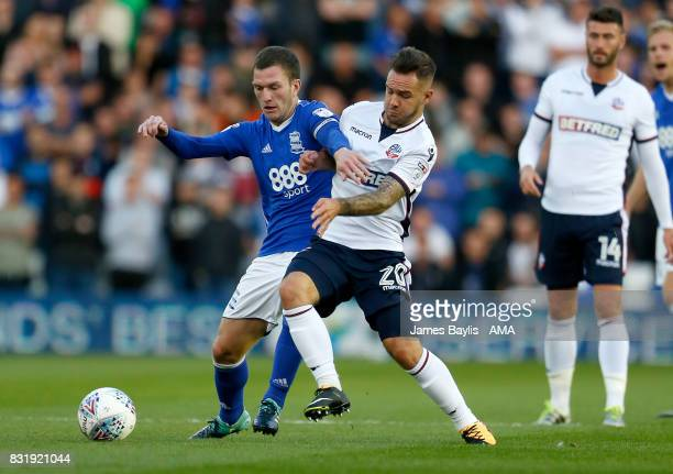 Craig Gardner of Birmingham City and Adam Armstrong of Bolton Wanderers during the Sky Bet Championship match between Birmingham City and Bolton...