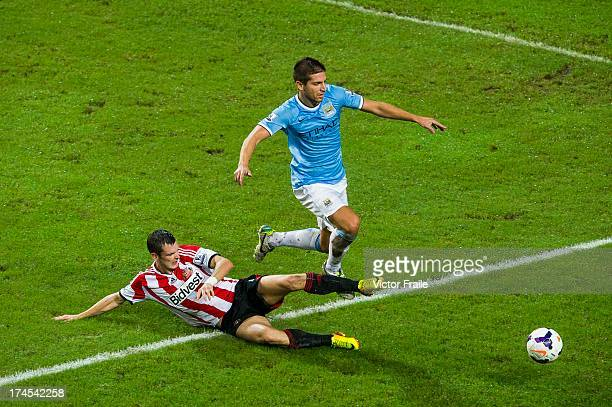 Craig Gardner of Sunderland AFC and Matija Nastasic of Manchester City FC compete for the ball during the Barclays Asia Trophy Final match between...