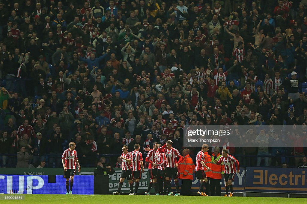 Craig Gardner of Sunderland celebrates with his team-mates after scoring his team's second goal to make the score 2-2 during the FA Cup with Budweiser Third Round match between Bolton Wanderers and Sunderland at the Reebok Stadium on January 5, 2013 in Bolton, England.