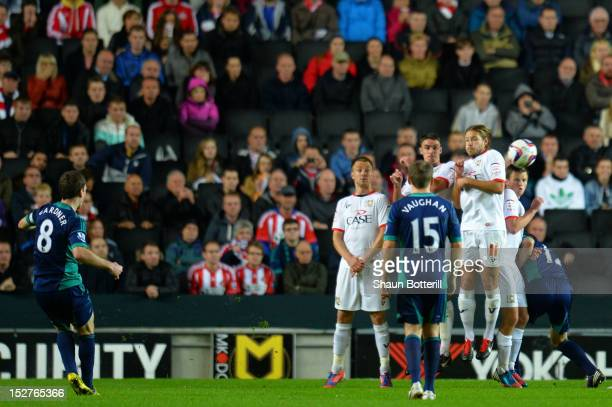 Craig Gardner of Sunderland scores the opening goal from a freekick during the Captial One Cup third round match between MK Dons and Sunderland at...