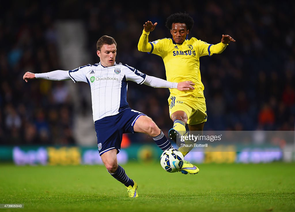 Craig Gardner of West Bromwich Albion and Juan Cuadrado of Chelsea battle for the ball during the Barclays Premier League match between West Bromwich Albion and Chelsea at The Hawthorns on May 18, 2015 in West Bromwich, England.
