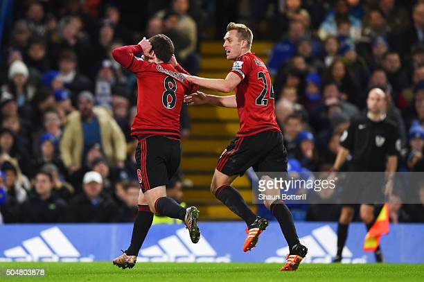 Craig Gardner of West Bromwich Albion celebrates scoring his team's first goal with his team mate Darren Fletcher during the Barclays Premier League...