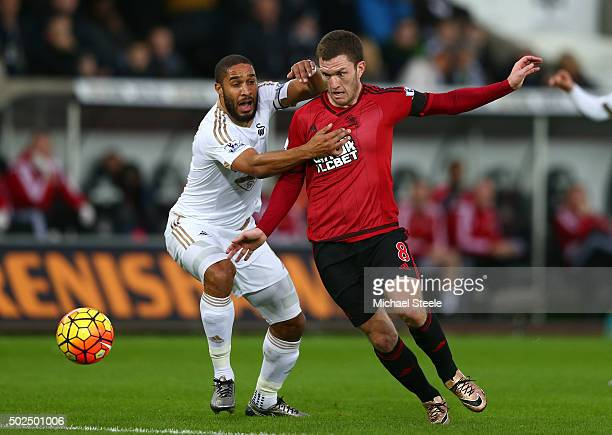 Craig Gardner of West Bromwich Albion is challenged by Ashley Williams of Swansea City during the Barclays Premier League match between Swansea City...