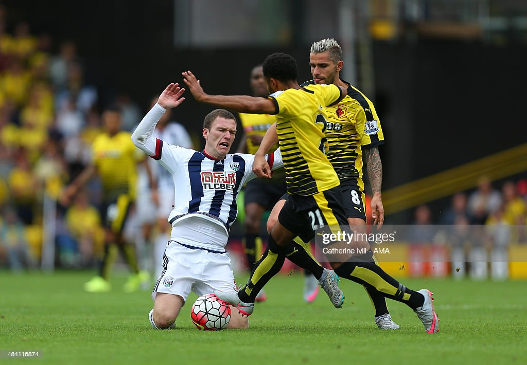 Craig Gardner of West Bromwich Albion is tackled by Ikechi Anya and Valon Behrami of Watford during the Barclays premier League match between Watford and West Bromwich Albion at Vicarage Road on August 15, 2015 in Watford, England.