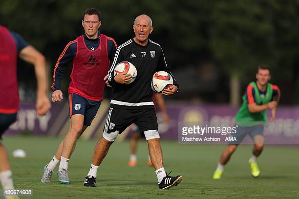 Craig Gardner shadowsTony Pulis the head coach / manager of West Bromwich Albion as he shouts out instructions during preseason training at the...